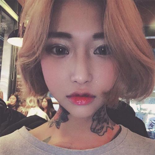 Nữ thợ xăm có vẻ đẹp búp bê gây sốt tại Hàn Quốc - 6