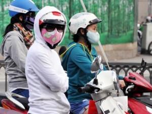 Tin tức Việt Nam - Sài Gòn se lạnh, người dân mặc áo ấm ra đường