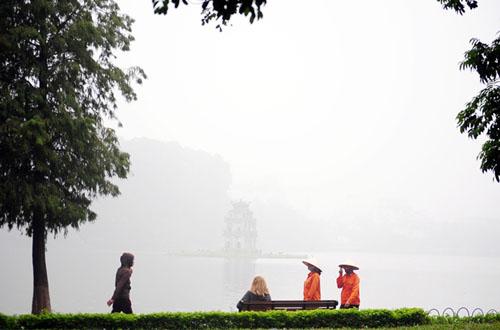 Ảnh: Sương mù dày đặc bao phủ Hà Nội - 21