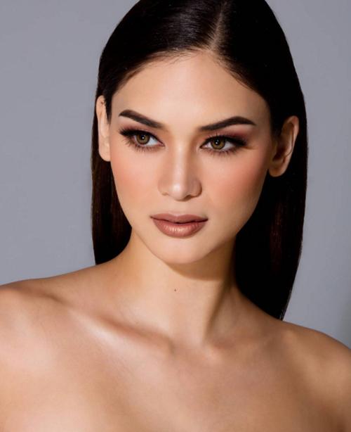 Vẻ đẹp đúng chuẩn sexy hiện đại của tân hoa hậu Hoàn vũ - 10