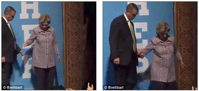 Bà Clinton ho sù sụ, phải nhờ mật vụ dìu xuống khán đài - 1