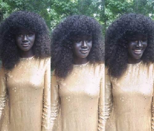 Cô gái trẻ có làn da đen kỳ lạ nhất thế giới - 4