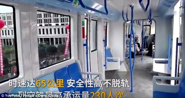 Trung Quốc ra mắt hệ thống tàu treo trên không đầu tiên - 3