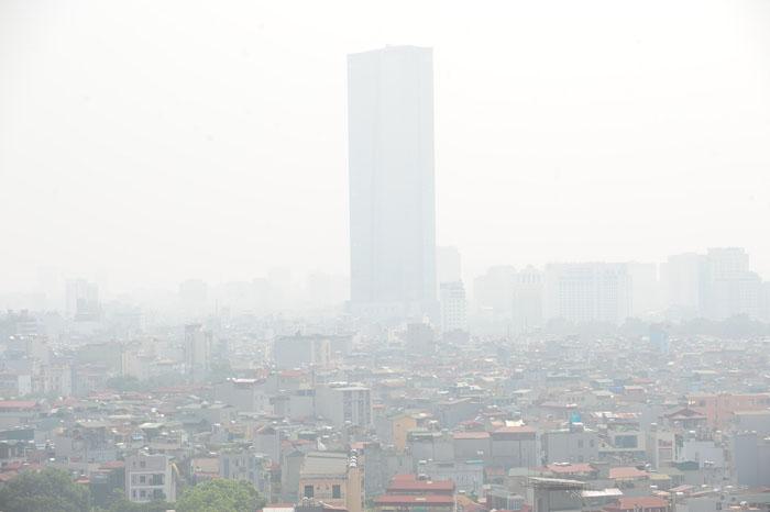 Ngột ngạt, cay mắt vì khói mù ở Hà Nội - 10