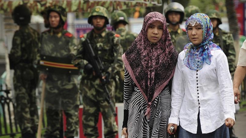 Trung Quốc cấm cha mẹ Tân Cương cho con theo tôn giáo - 1