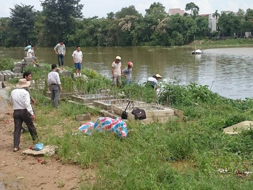 Thả lưới bắt cá, hoảng hồn phát hiện xác chết - 1
