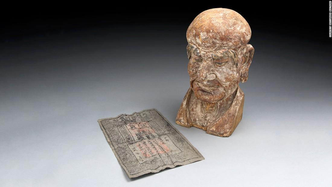 TQ: Phát hiện báu vật trong đầu tượng Phật 700 tuổi - 1