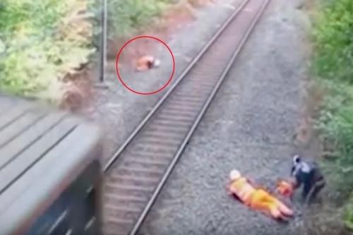 Thót tim công nhân đường sắt cứu người trước tàu hỏa - 2