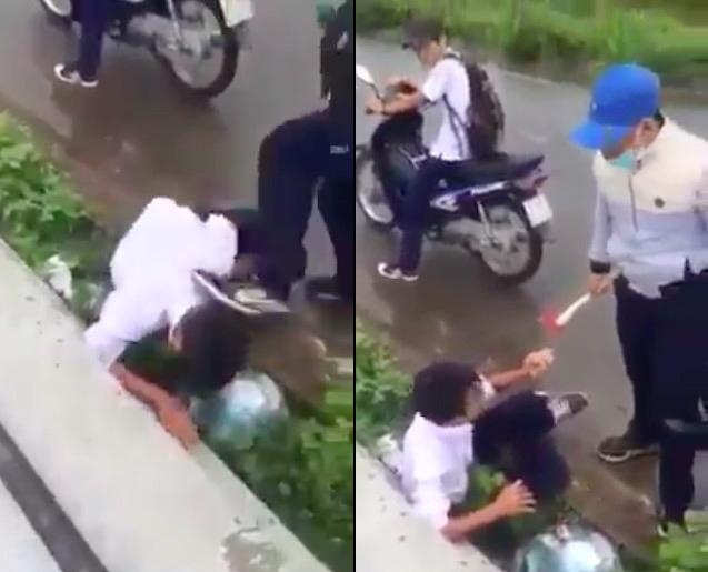 Clip: Nam sinh đánh, đạp liên tiếp vào đầu bạn giữa đường - 1