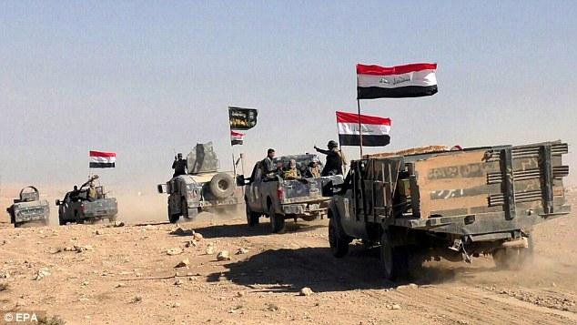 IS truy lùng 5 thủ lĩnh ôm hàng triệu USD bỏ trốn - 2