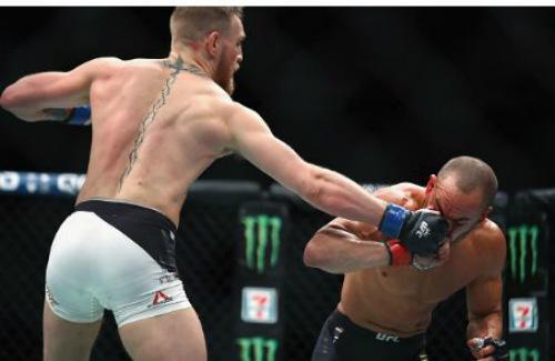 """Thắng siêu tốc, """"Gã điên"""" McGregor tạo kỳ tích UFC - 2"""