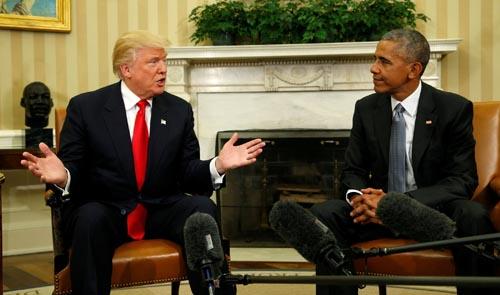 Trump có biểu hiện ngày càng giống Obama - 1