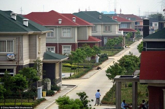 Ảnh: Ngôi làng giàu nhất TQ, mỗi người được cấp 3 tỉ đồng - 8