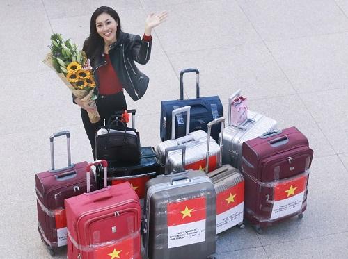 Hoa khôi Diệu Ngọc mang 100kg hành lý đi thi Miss World - 1