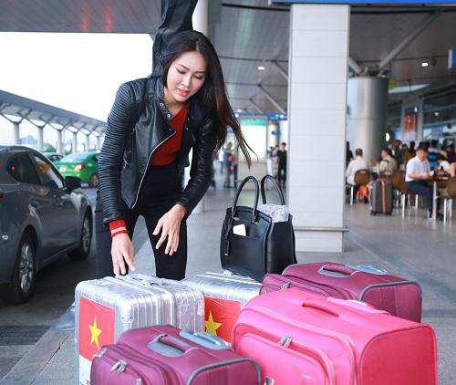 Hoa khôi Diệu Ngọc mang 100kg hành lý đi thi Miss World - 5