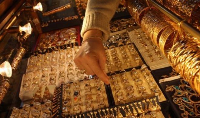 Giá vàng hôm nay 26/11: Thấp kỷ lục trong hơn 9 tháng - 1