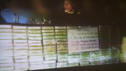 Giấu 300 bánh heroin trong can nhựa mang đi tiêu thụ - 1