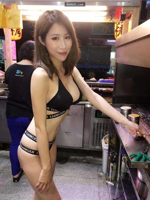 Hot girl bán thịt xiên nướng TQ khiến quán ăn đông khách gấp bội - 1