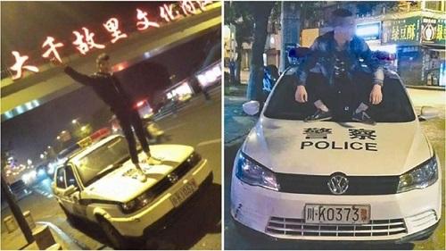 Thanh niên nghịch dại livestream trên mui xe cảnh sát - 1