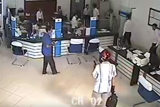 Nghi phạm tự sát, vụ cướp ngân hàng ở Vĩnh Long giải quyết ra sao? - 1