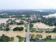 Flycam: Toàn cảnh nước ngập đến nóc nhà sau trận lụt lịch sử ở Chương Mỹ