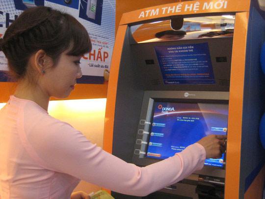 Chủ thẻ ATM có bị khống chế rút 5 triệu đồng/ngày? - 1