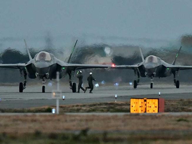Nhật Bản ráo riết mua thêm tên lửa tầm xa - 1