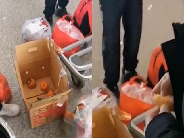 Tiếc tiền ký gửi, 4 thanh niên ăn hết 30kg cam tại sân bay và cái kết đắng