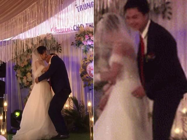 Chú rể ghì chặt cô dâu hôn ngấu nghiến, phản ứng của cô dâu gây bất ngờ