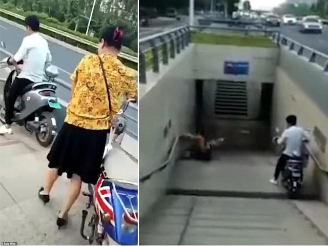 Cái kết cực thốn khi phụ nữ dắt xe điện xuống cầu thang