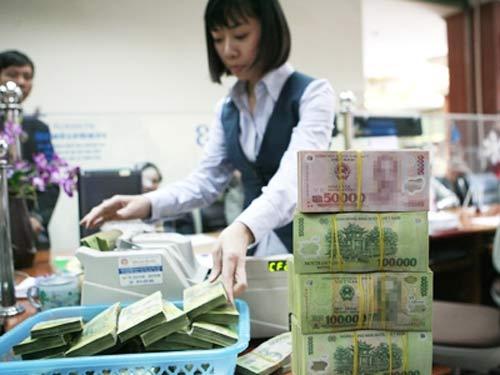 NH vẫn hưởng lợi từ giảm lãi suất tiền gửi - 1
