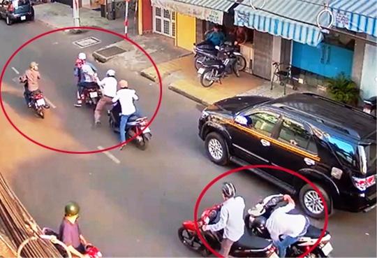 Cả chục người nhìn cướp kéo lê nạn nhân không chút hỗ trợ - 1