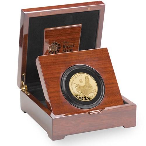 Đồng xu vàng khắc biểu tượng năm Đinh Dậu giá... 235 triệu đồng - 1