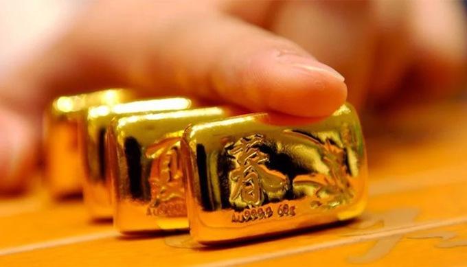 Giá vàng hôm nay 25/1: Vàng bị tranh mua, giá tăng sốc - 1