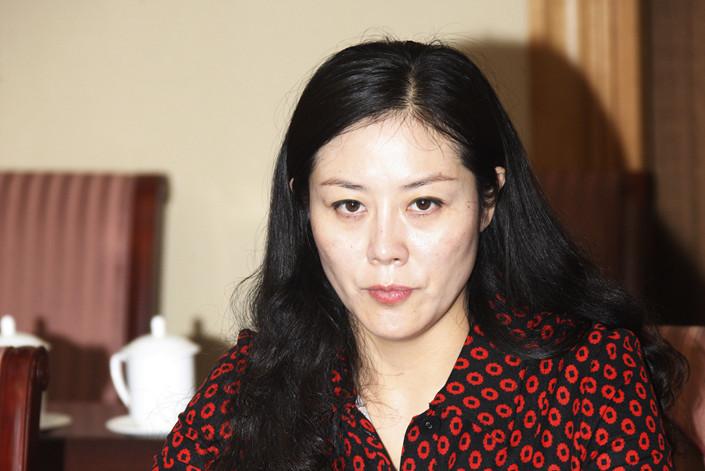Nữ quan chức Trung Quốc xinh đẹp đổi tình dục lấy quyền lực - 1