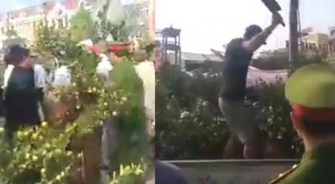 Người đàn ông cầm dao leo lên xe ô tô công vụ chặt các cây quất khi bị xử lý - 1