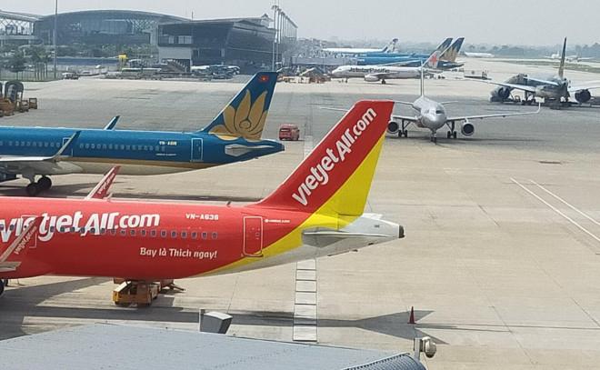 Ngừng tất cả chuyến bay đến vùng có dịch virus Corona ở Trung Quốc - 1