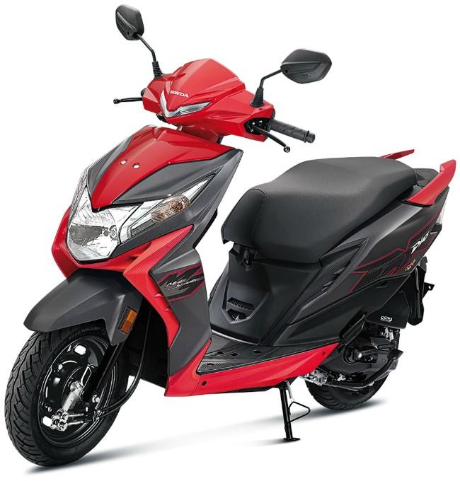 Honda đang tiếp tục làm việc để chuyển đổi các mẫu xe đạt tiêu chuẩn khí thải BS4 lên chuẩn BS6 ở thị trường Ấn Độ. Mới đây nhất nhà sản xuất xe này đã chính thức tung ra xe ga 2020 Honda Dio đạt chuẩn BS6, với giá chỉ đắt hơn bản BS4 có 7.000 RS (2,28 triệu VNĐ). Ảnh 2020 Honda Dio bản tiêu chuẩn màu đỏ.