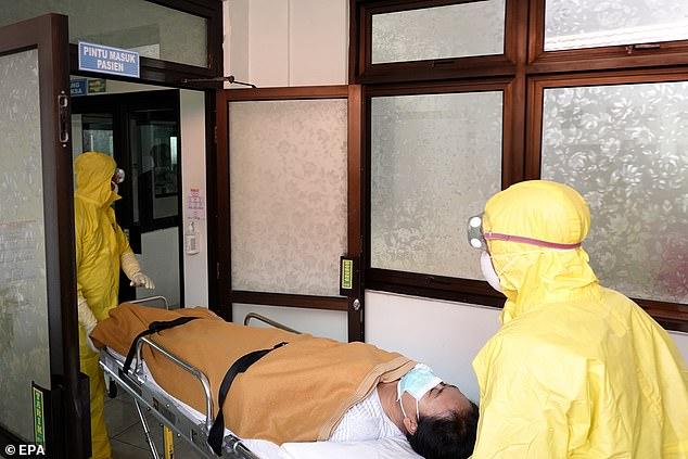 Du khách Trung Quốc dương tính với virus Corona sau khi trở về từ Indonesia - 1