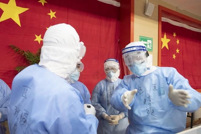 Virus Corona: Hơn 2.600 ca nhiễm mới ở Trung Quốc, 1.526 người tử vong - 1