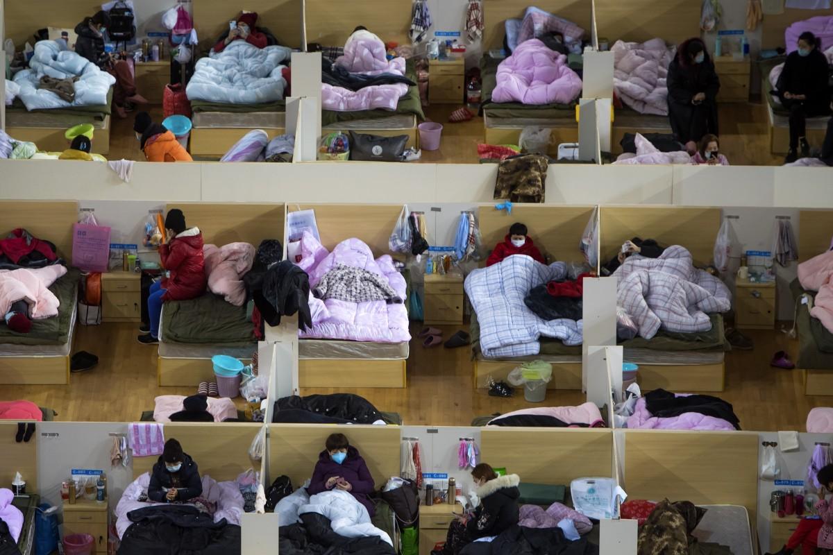 Virus Corona: Số người tử vong ở Trung Quốc lên tới hơn 2.000 người - 1
