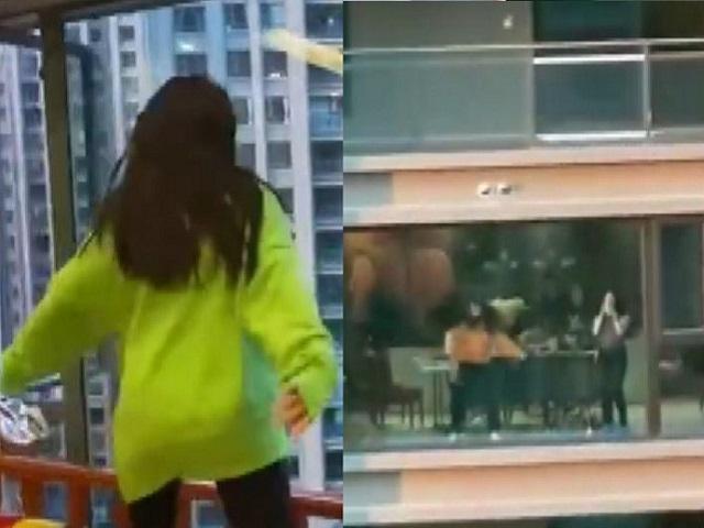Bị cách ly vì Covid-19, hai gái trẻ ở hai tòa nhà đối diện thi đấu vũ điệu bốc lửa - 1