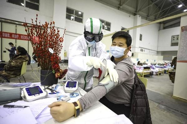 Trung Quốc: Xuất viện 10 ngày, bệnh nhân Covid-19 tái nhiễm - 1