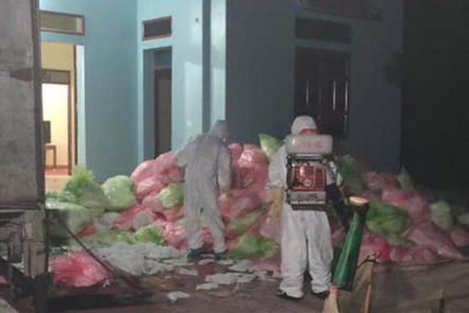 Hơn 600kg khẩu trang qua sử dụng thu gom ở Vĩnh Phúc được cất giấu tại Hà Nội - 1