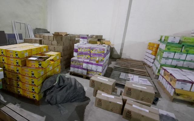 """Gần 70.000 chai nước giải khát hết hạn được """"phù phép"""" thành hàng mới tại Hà Nội - 1"""