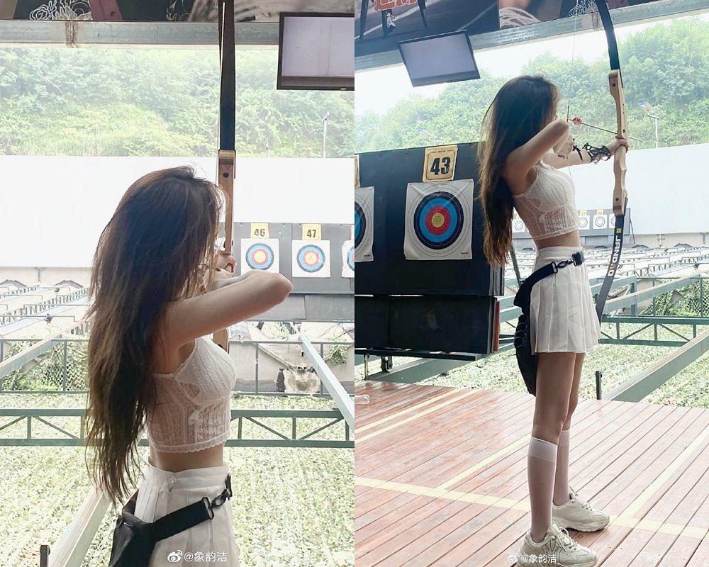 Người đẹp Trung Quốc được chú ý với set đồ croptop ren khi bắn cung - 1