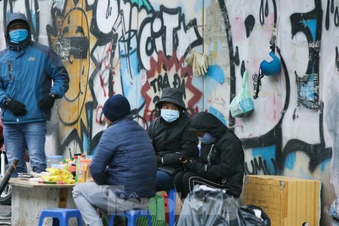Cuộc sống đảo lộn của người lao động Thủ đô trong ngày lạnh nhất từ đầu mùa - 9
