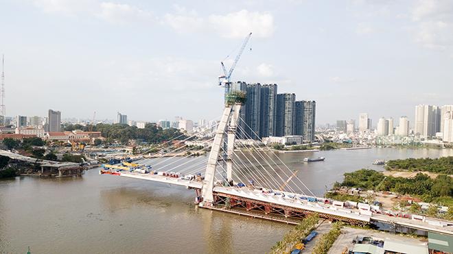 """Ảnh: Cầu biểu tượng mới ở TP.HCM bắc qua sông Sài Gòn """"đứng hình"""" sau 5 năm khởi công - 4"""