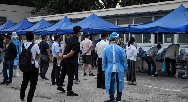 Trung Quốc đưa thêm phương pháp lấy dịch hậu môn vào quá trình xét nghiệm Covid-19 - 1