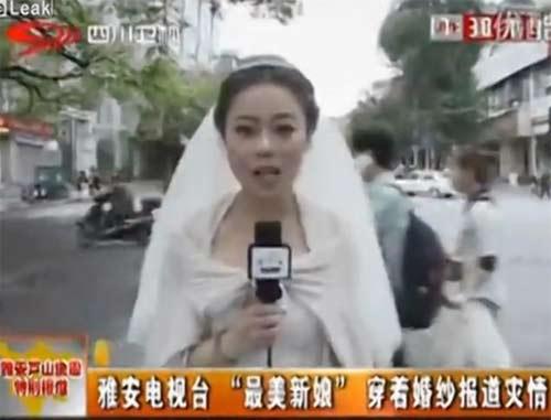 TQ: Cô dâu mặc váy cưới, đưa tin về động đất - 1